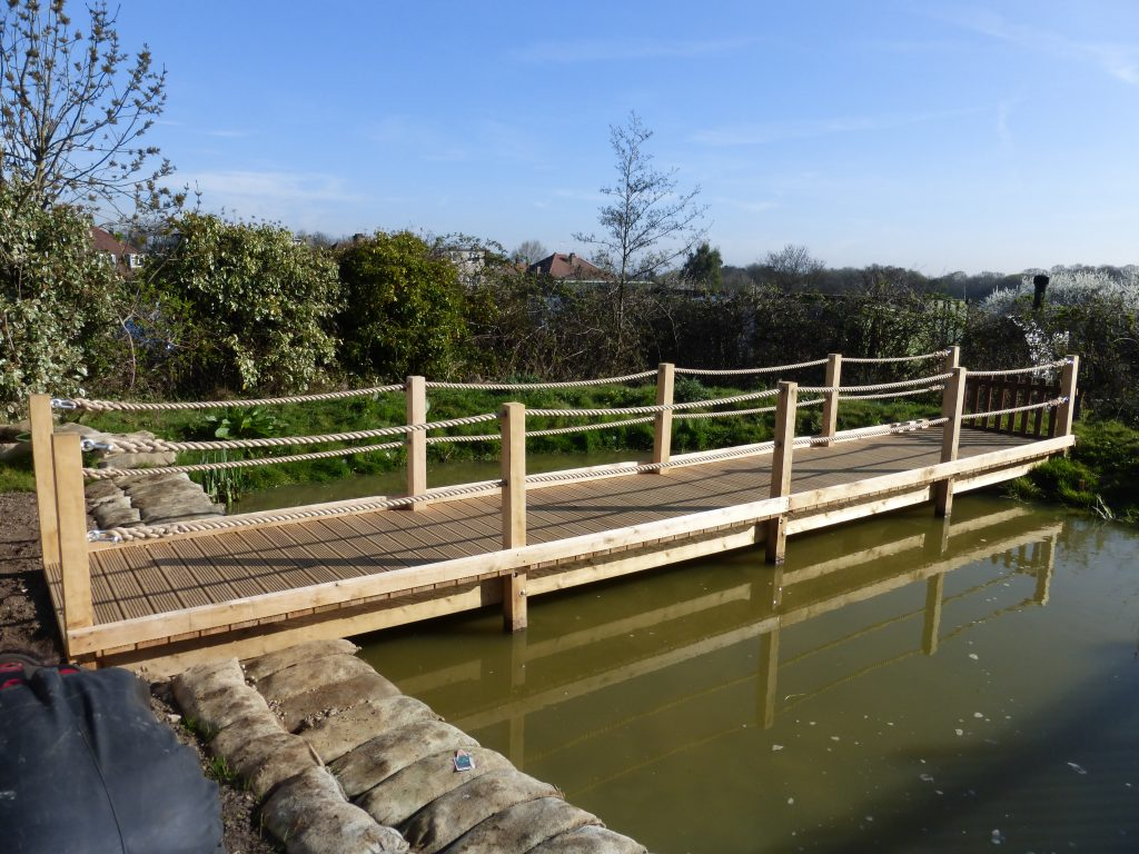 bridge-style-pond-diping-platform-with-rope-handles-by-the-wild-deck-company