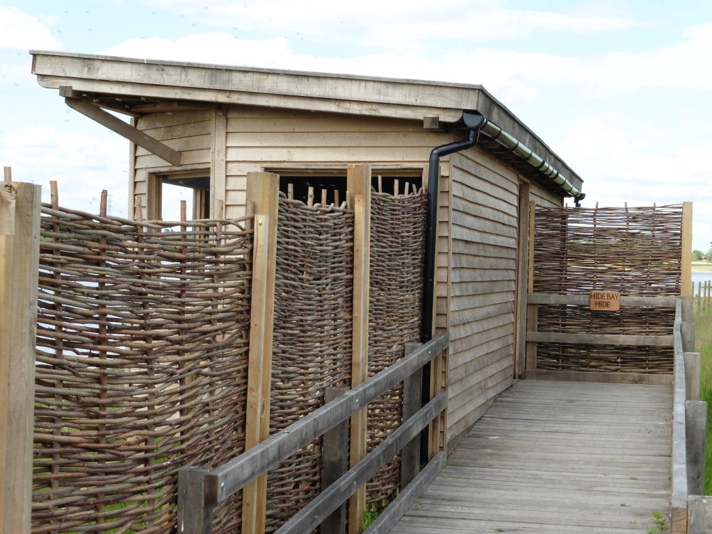 Entrance with sign hide bay bird hide with sedum roof at abberton reservoir for essex wildlife trust