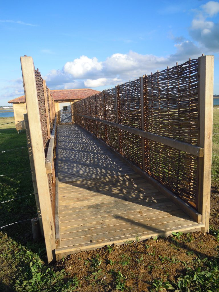 Entrance and walkway island bird hide at abberton reservoir for essex wildlife trust