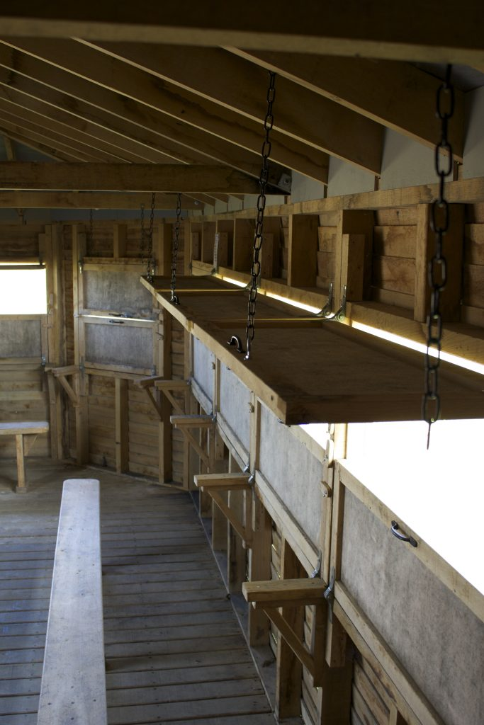 Interior with shutters open island bird hide at abberton reservoir for essex wildlife trust