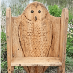 owl-themed-carving-bench-seating-by-the-wild-deck-company