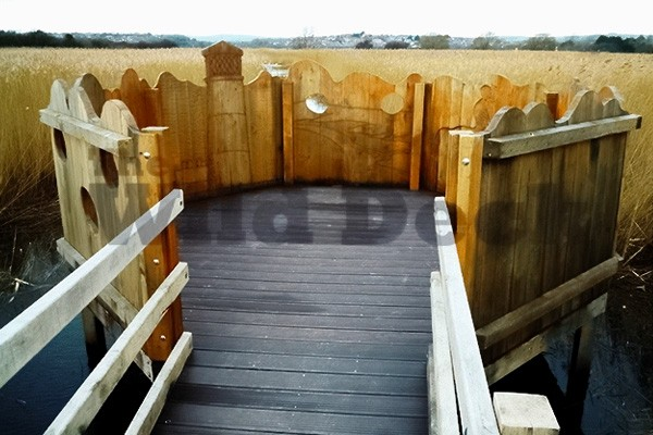 rspb-radipole-hexagonal-viewing-platform-customised-with-carvings-and-raised-over-water-by-the-wild-deck-company