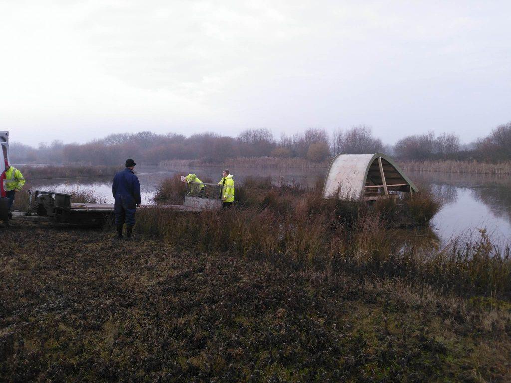 Removing trailer sand martin bank installation at abberton reservoir for essex wildlife trust