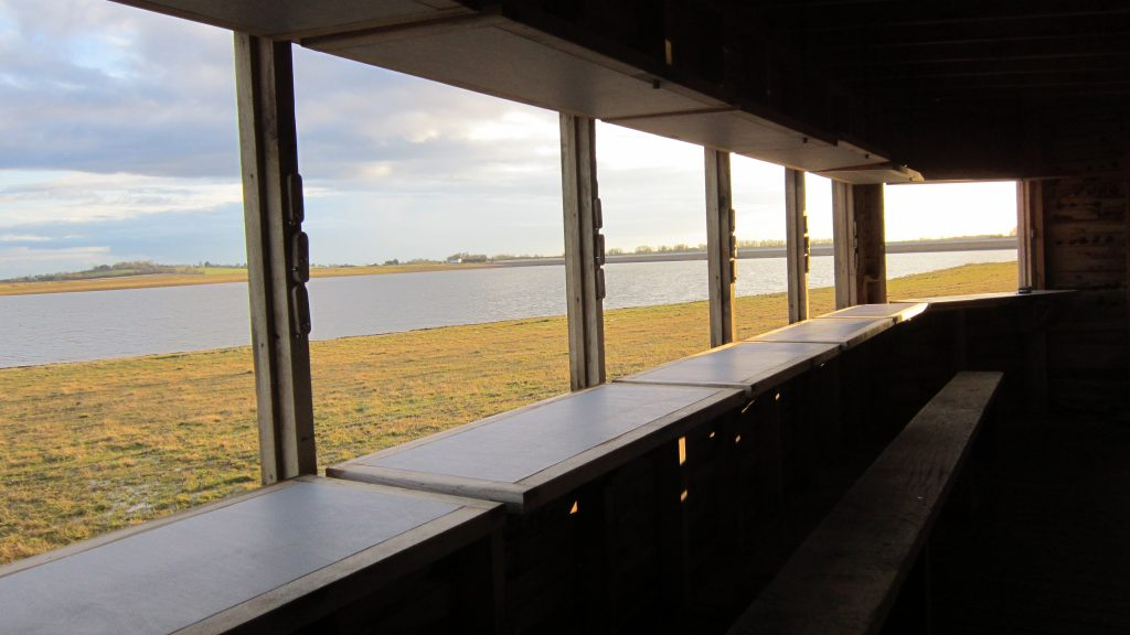 View from inside gwens hide bird hide for essex wildlife trust at abberton reservoir
