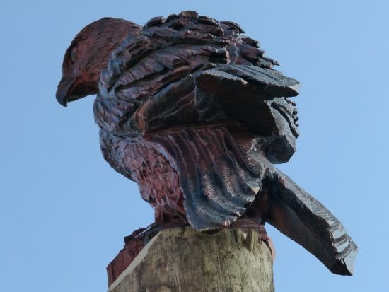 bird of prey carving animal wood