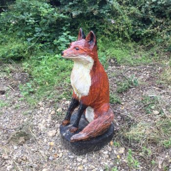 fox carving in forest
