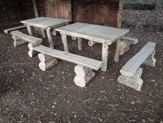 picnic benches with split log