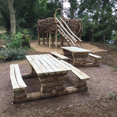 rustic picnic benches and herons nest play area