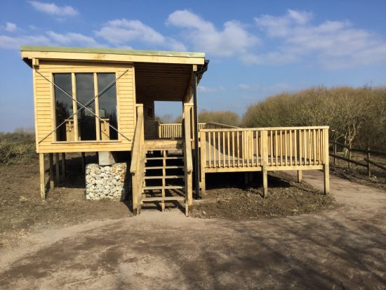 side of bird hide at rspb pagham harbour
