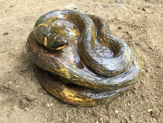 snake carving coiled wooden sculpture rushden lakes